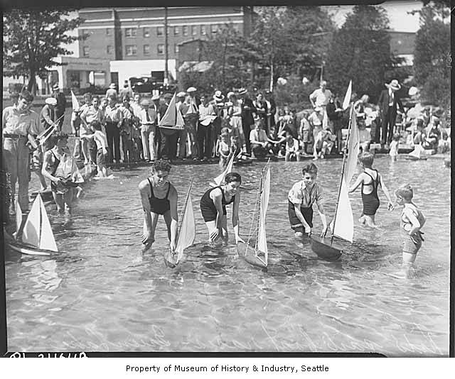 Boys_sailing_boats_in_Green_Lake_wading_pool_Seattle_Summer_1934 copy